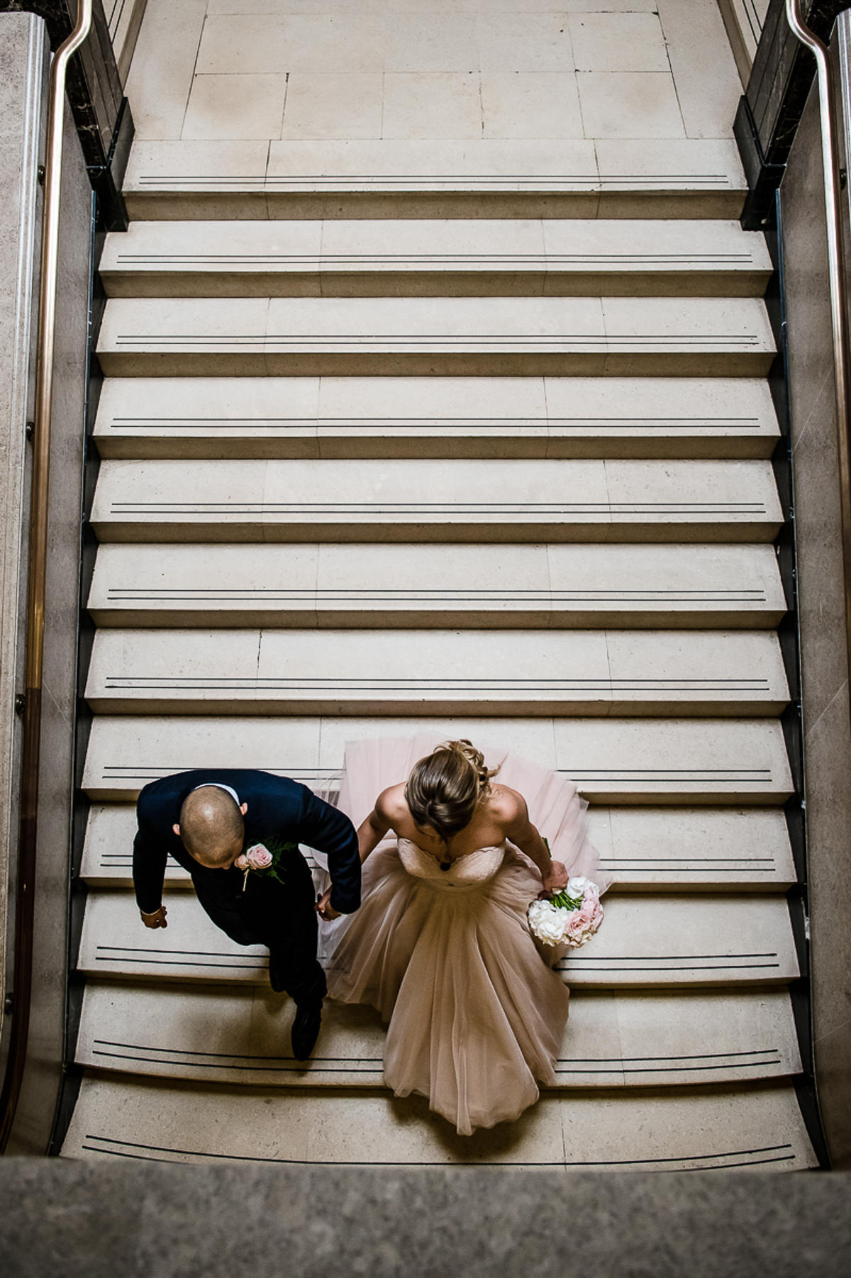 bride and groom going downstairs at the town hall