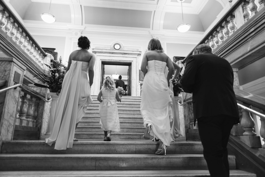 bride going upstairs at islington town hall