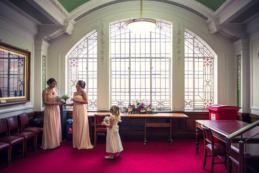 brides waiting to go in to the ceremony in the Council Chamber at Islington town hall