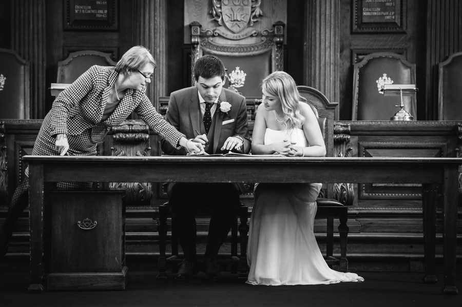 Nick and Catherine signing the register