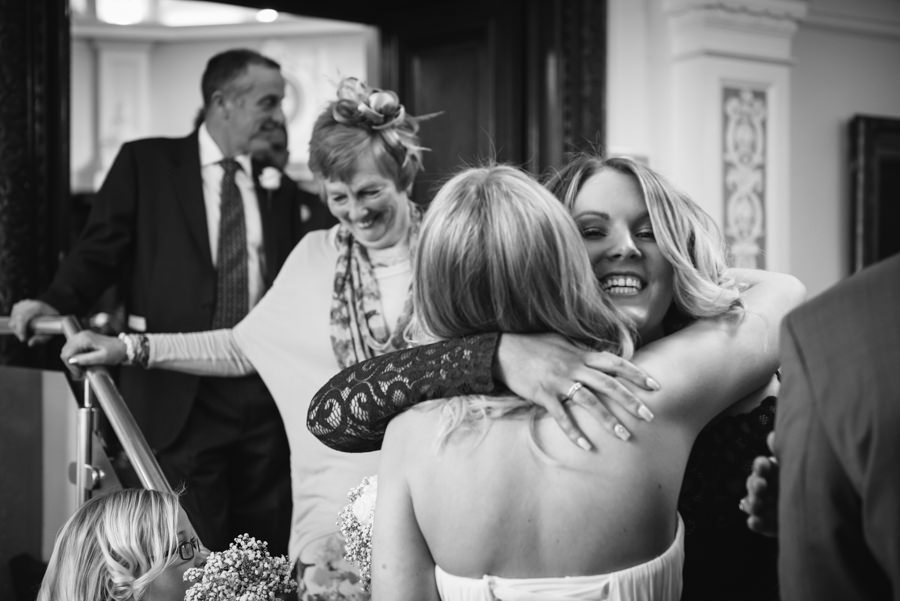 bride hugging wedding guests