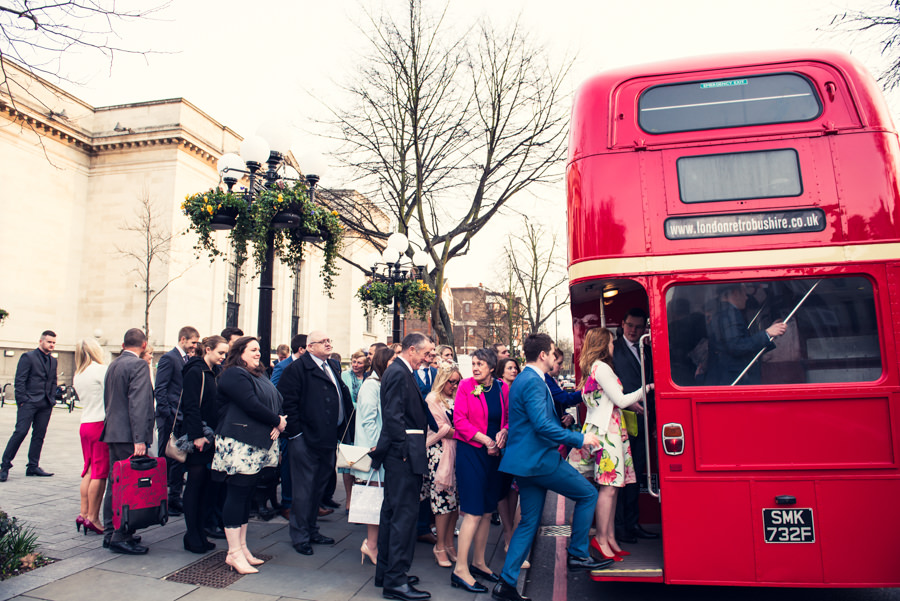 guests boarding wedding bus