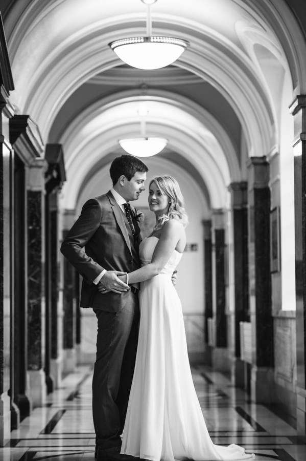 bride and groom in the corridors at islington town hall
