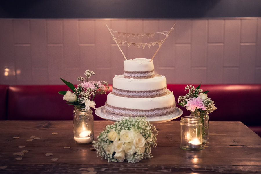 wedding cake, candles and flowers at the Artisan of Clerkenwell wedding reception