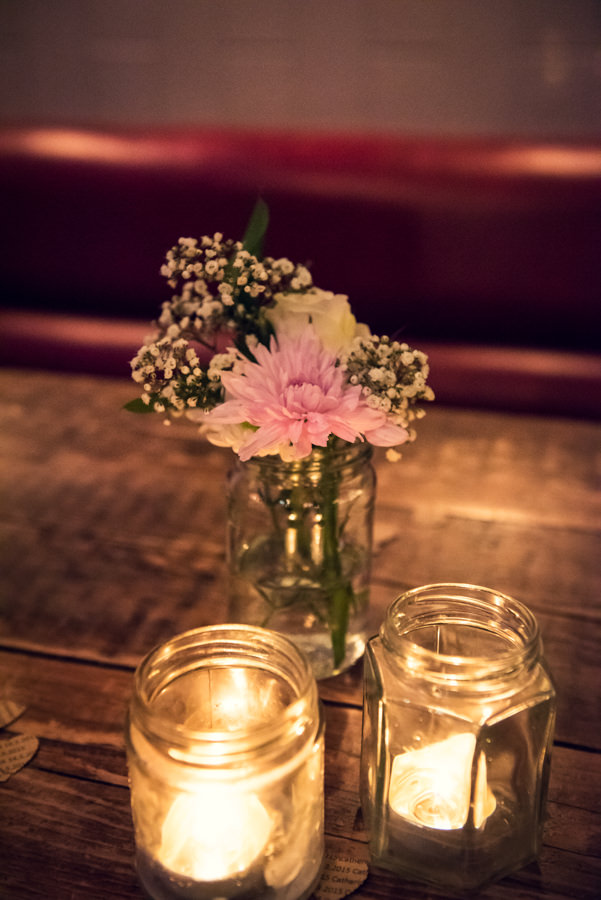 flowers and candle details at the Artisan of Clerkenwell wedding reception