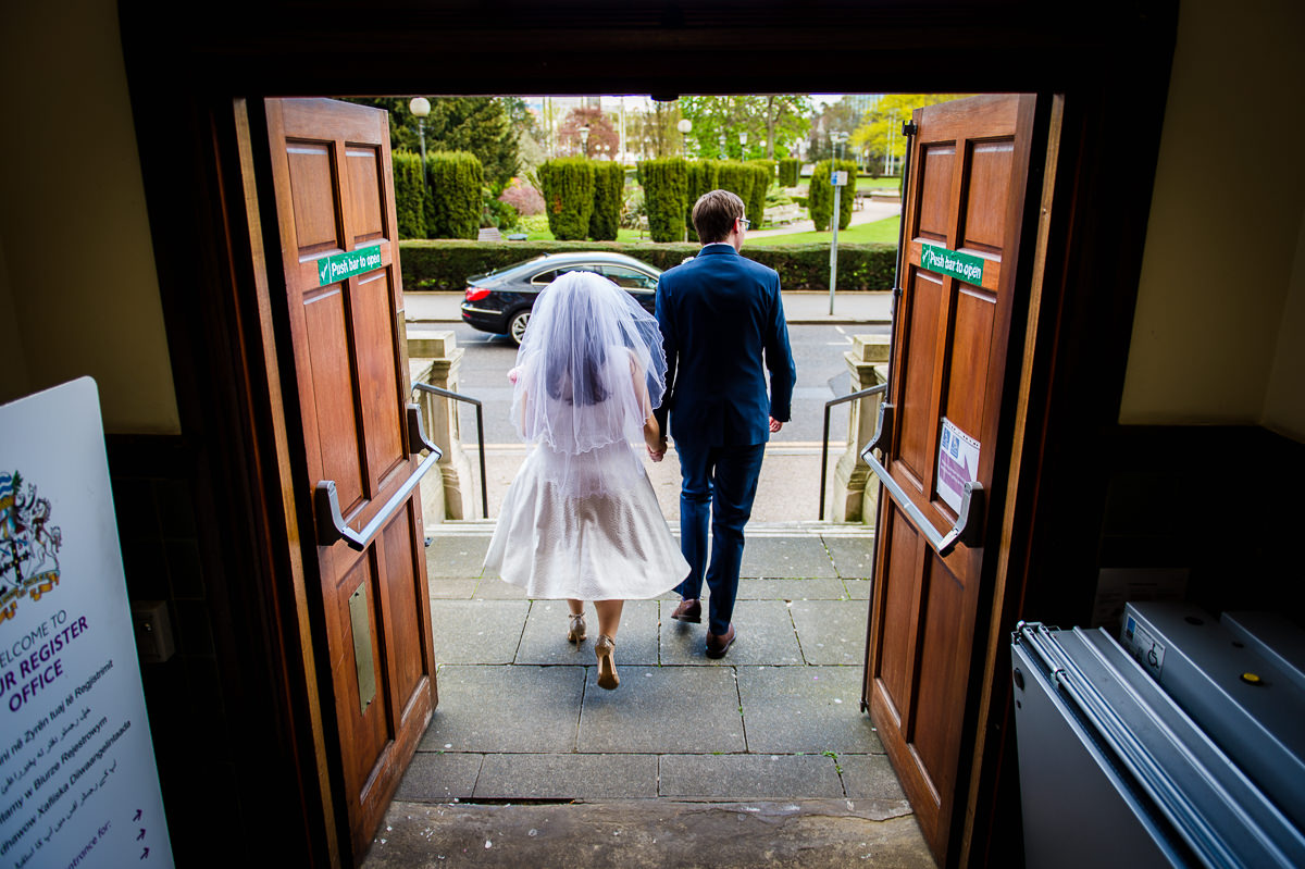 Bride and Groom leaving their wedding at croydon registry office