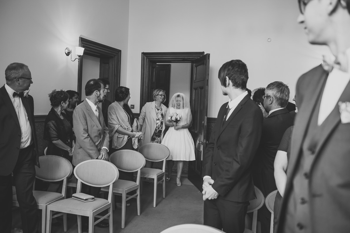 Bride enters the ceremony room at Croydon Registry office