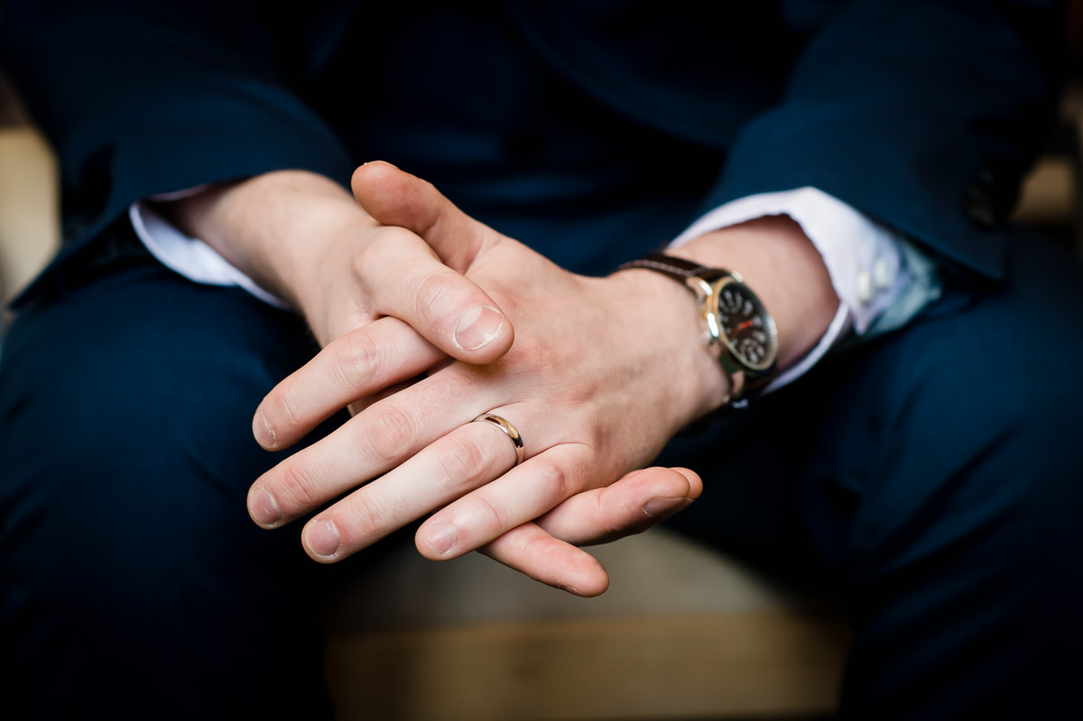 Groom's hands and wedding ring
