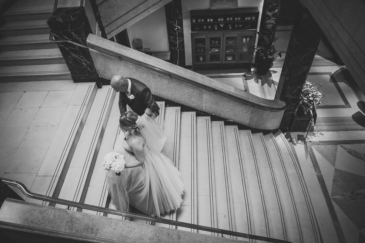 Bethnal Green Town Hall Hotel wedding bride walking upstairs with father