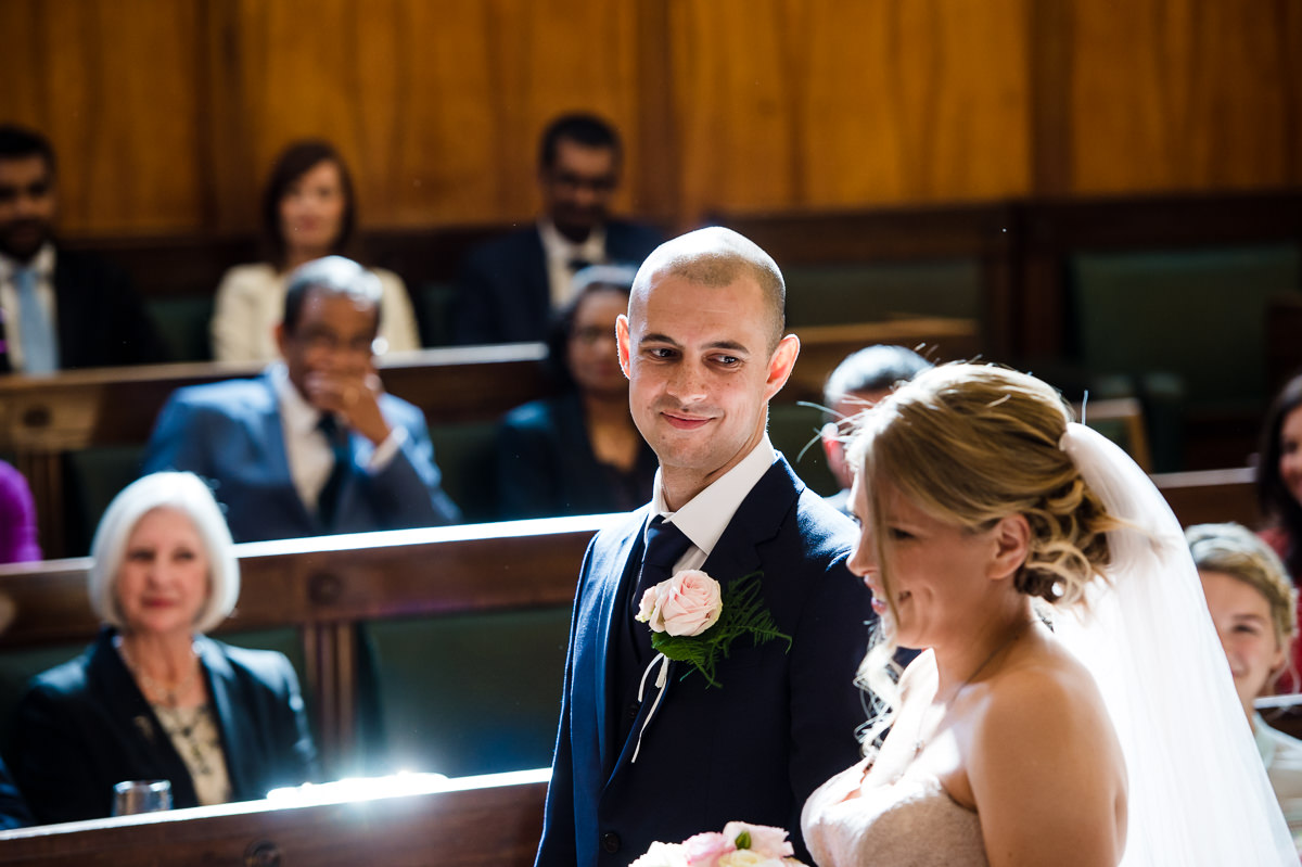 Town Hall Hotel wedding groom looks lovingly at bride