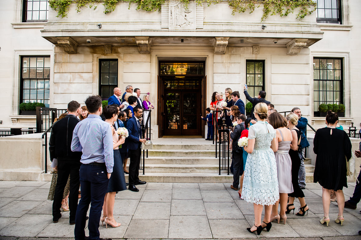 Bethnal Green Town Hall Hotel wedding families waiting outside with confetti
