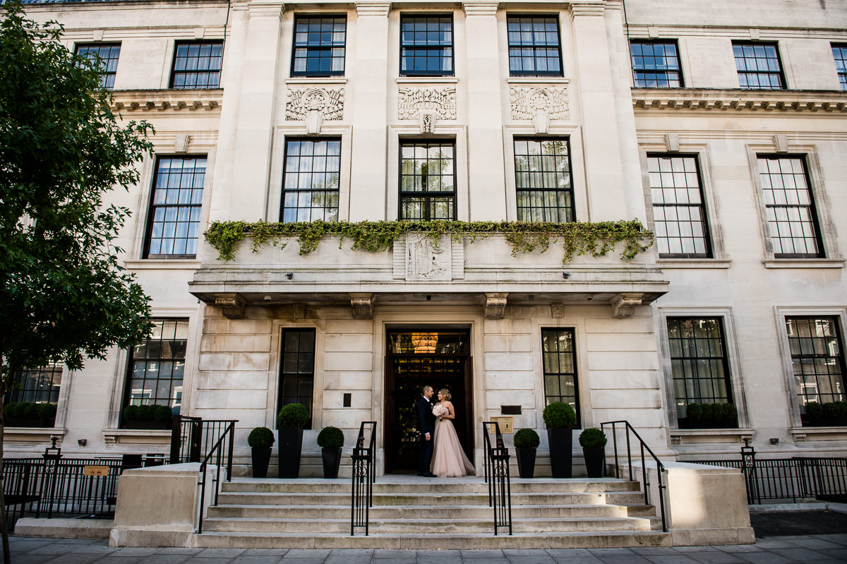 Bethnal Green Town Hall Hotel wedding bride and groom on outside steps