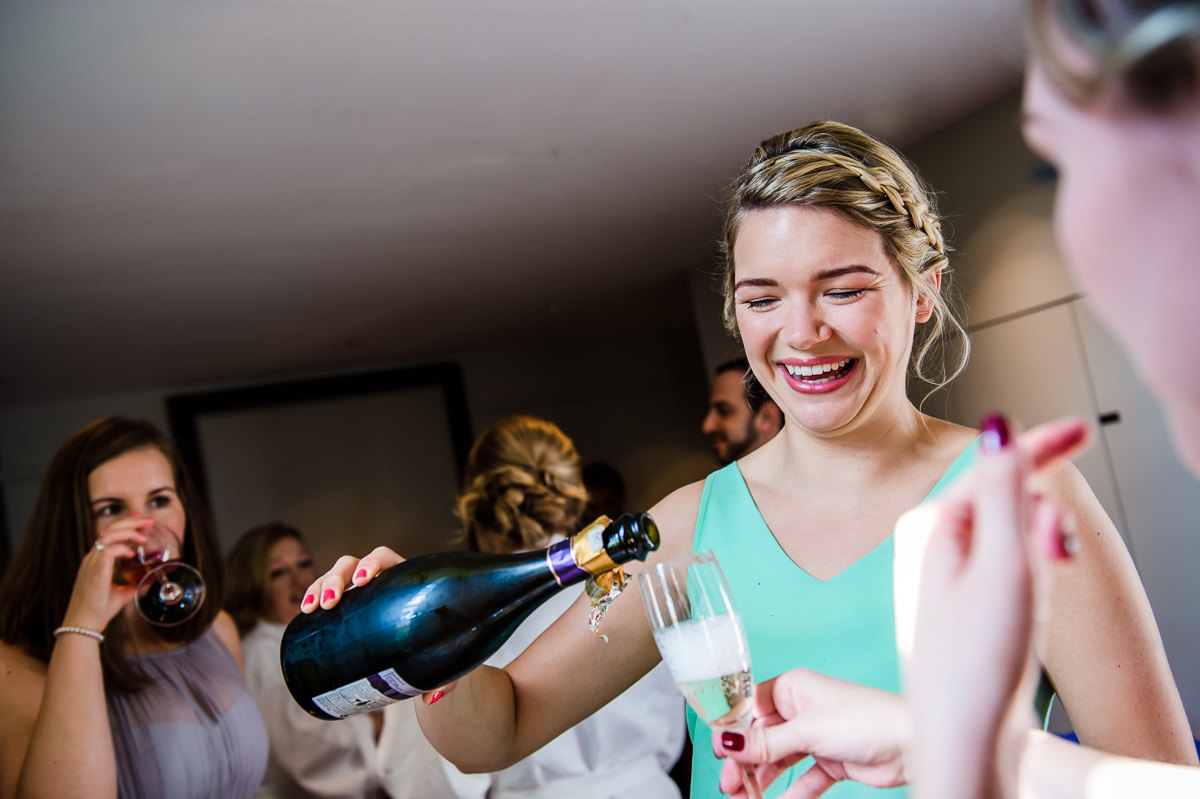 Bethnal Green Town Hall Hotel wedding - bridesmaids drinking prosecco
