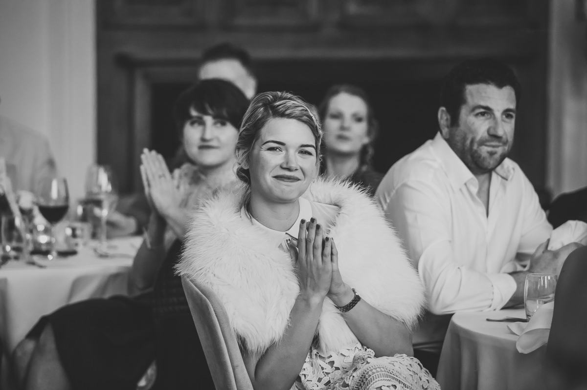 Wedding guests clapping to emotional speeches