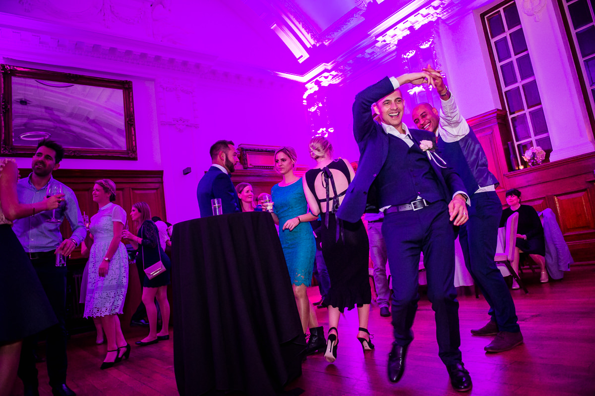 Groom and guests dancing