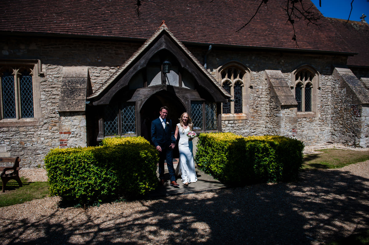 newly weds leaving church in west sussex
