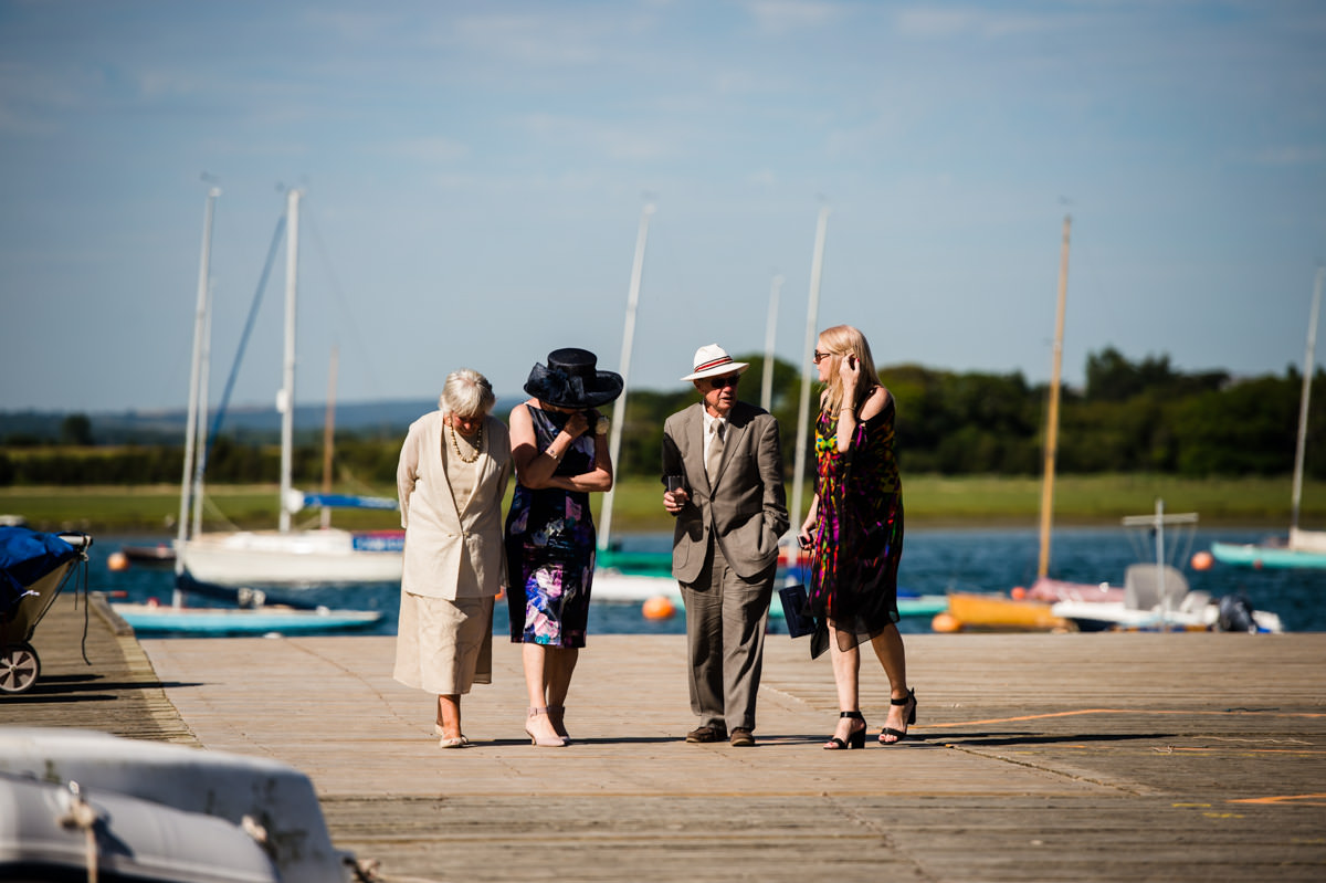 Weddings guests walking at Itchenor Sailing Club