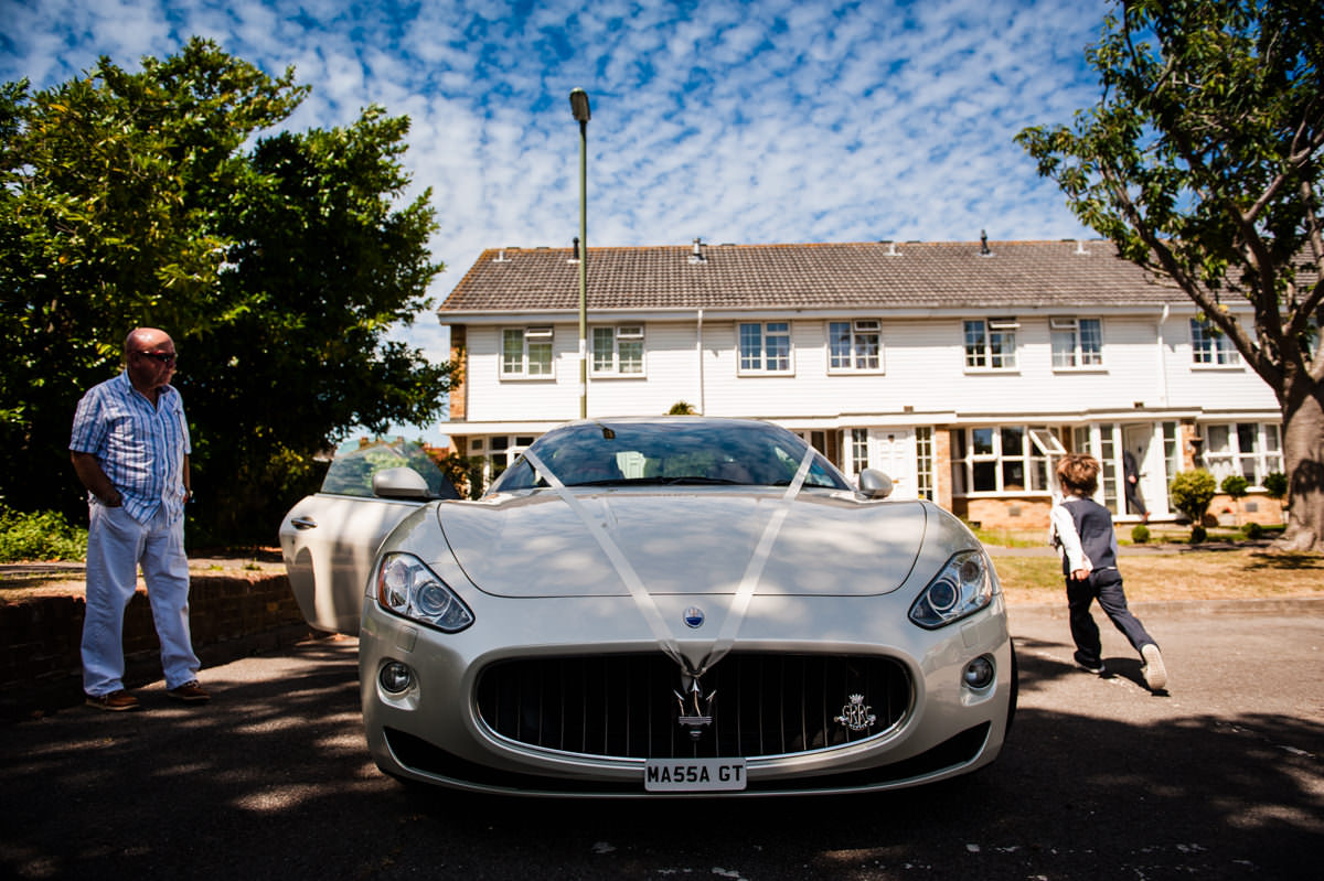 wedding maserati waiting for the groom