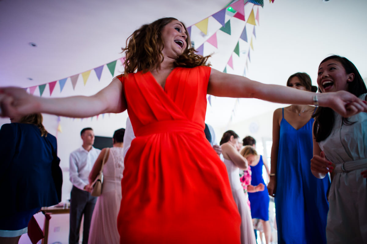 Happy guests dancing at Itchenor Sailing Club wedding