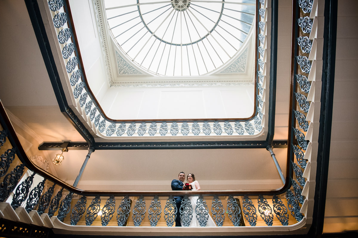 Newly weds on the famous staircase at the Grand Hotel in Brighton