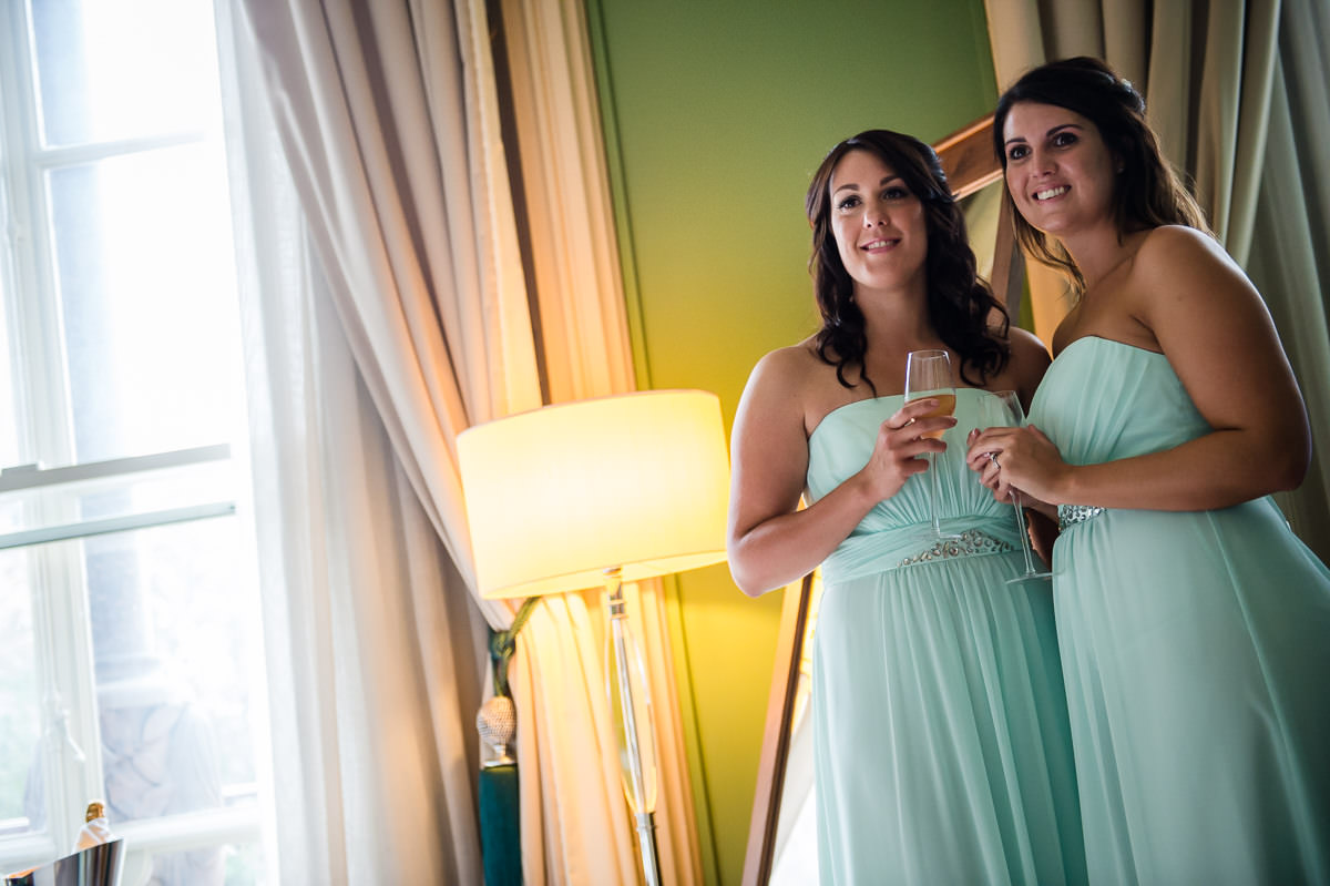 Bridesmaids posing for a photo at St Pancras Renaissance Hotel, London
