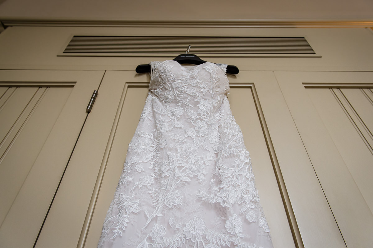 Wedding dress hanging up from wardrobe