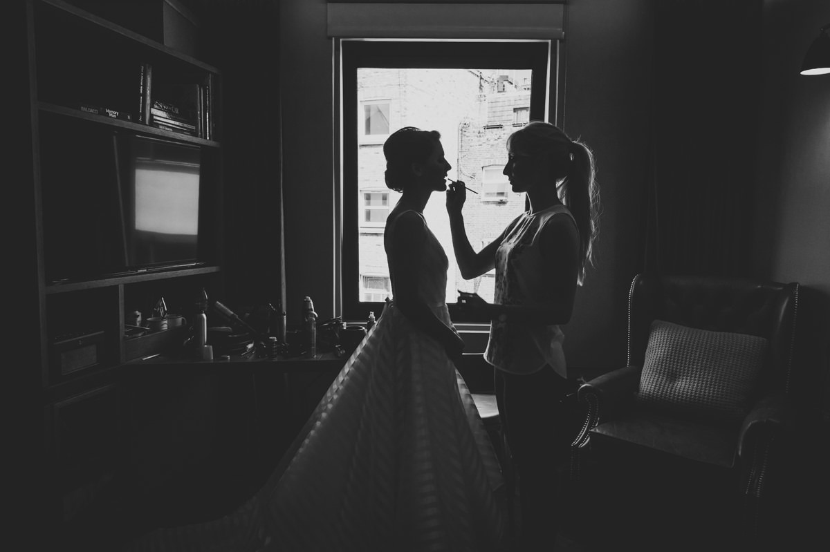 black & white silhouette portrait of bride getting ready at Hoxton Hotel Shoreditch