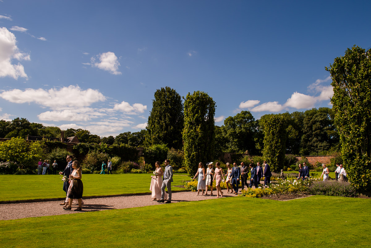 Wedding guests walking around Arley Hall & Gardens