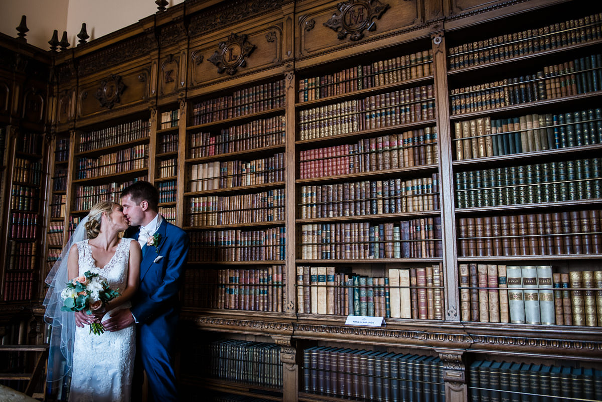 Bride & Groom in the library at Arley Hall
