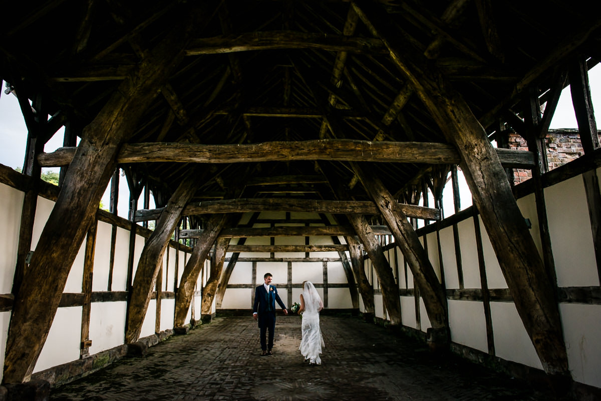 Bride & Groom in the old barn at Arley Hall