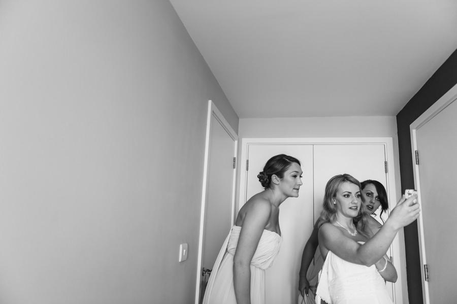 bride dressing for her wedding