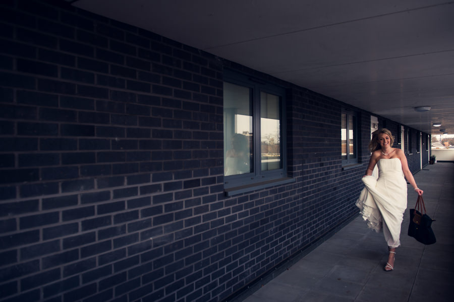 Bride running as she's late for her wedding at islington town hall
