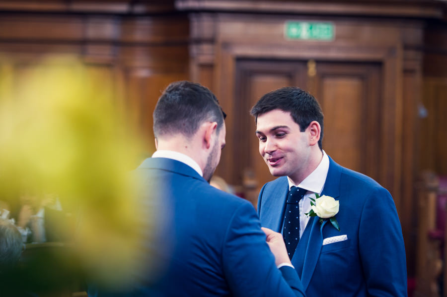 groom chatting to his best man