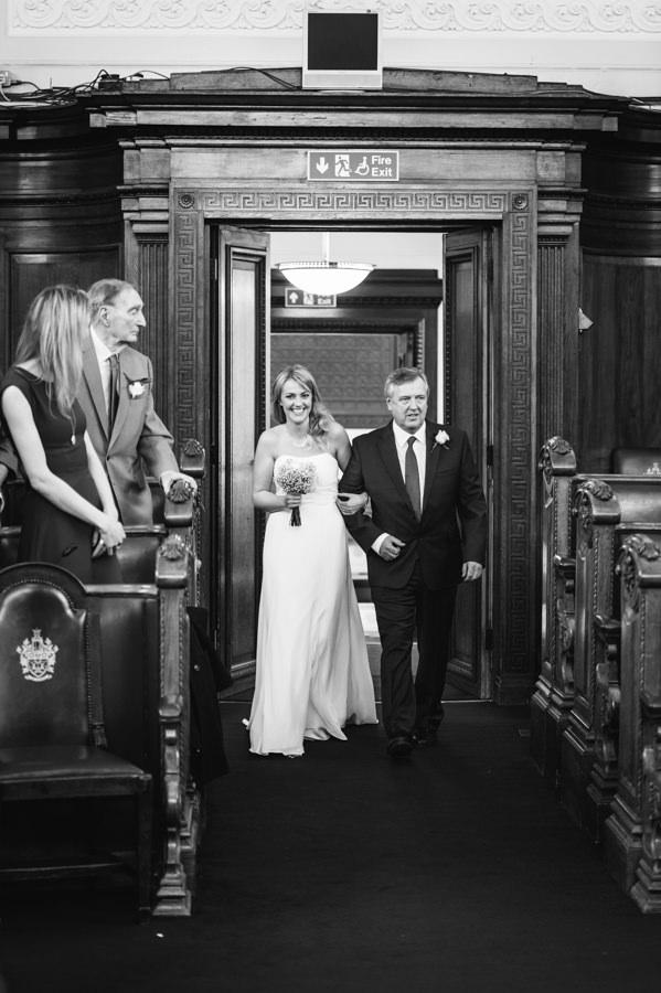 bride walking down the aisle at islington town hall