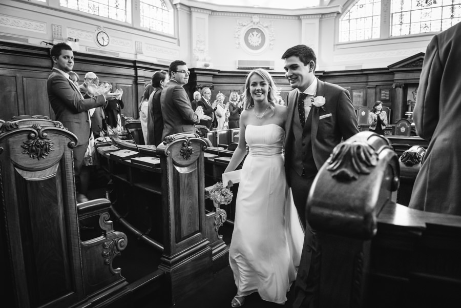 bride and groom leaving the council chamber at islington town hall as newly weds
