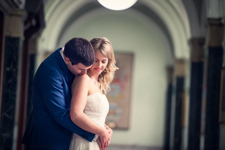 photo of groom kissing his brides shoulder