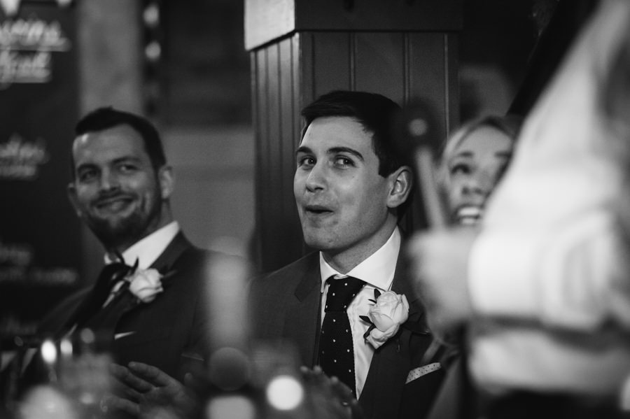 Groom reacting to speeches
