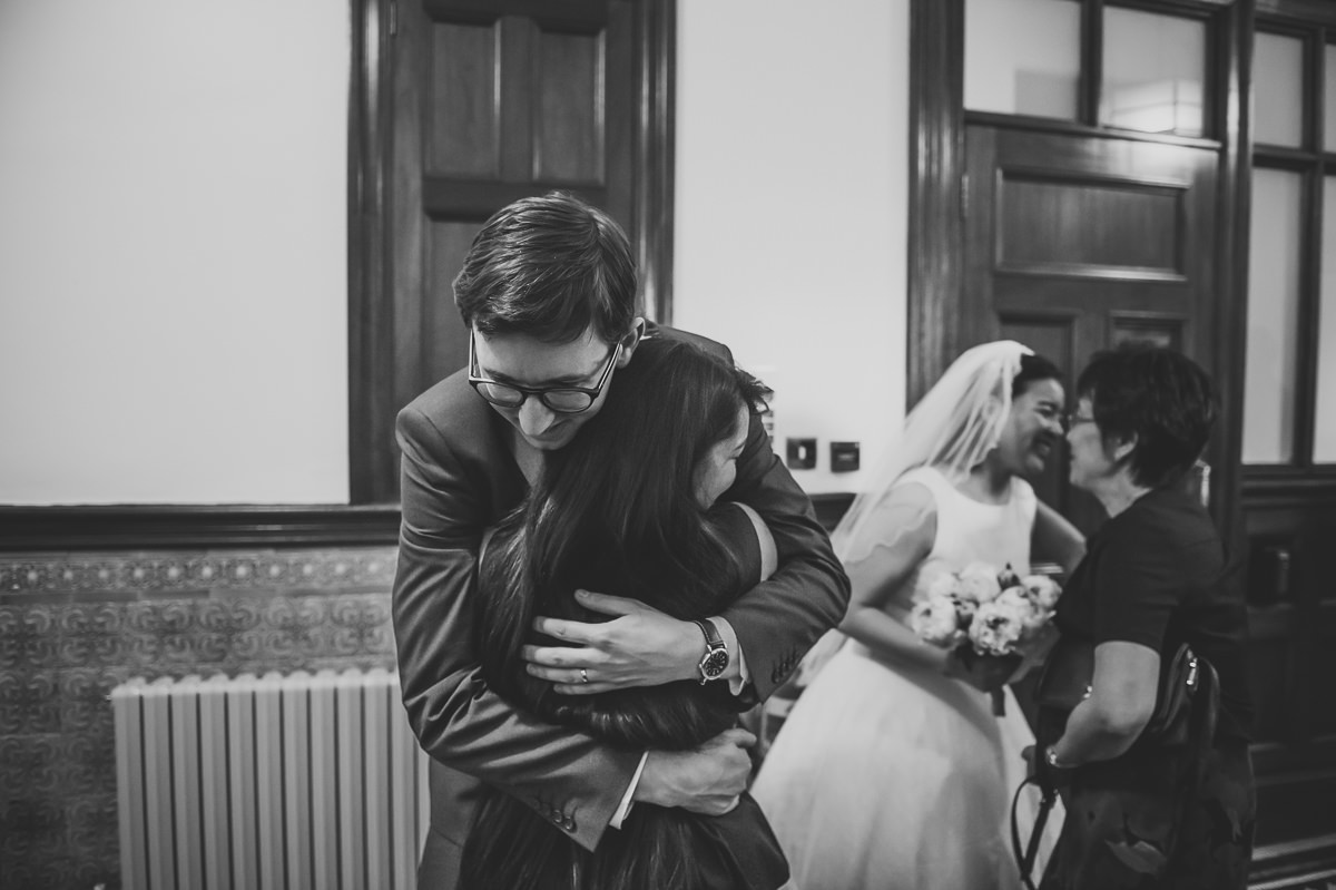 Newly weds hugging guests at their Surrey Wedding