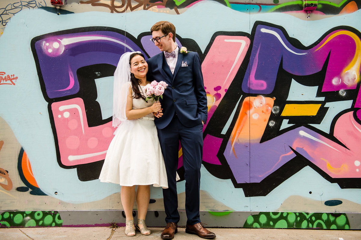 Bride and Groom in front of graffiti wall after their Croydon Registry office wedding