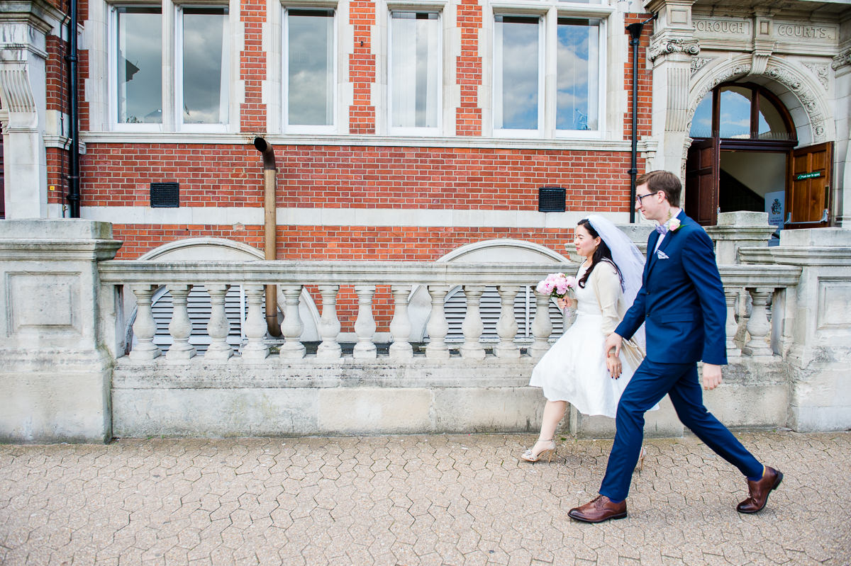 Bride and Groom entering Croydon Registry office for their wedding