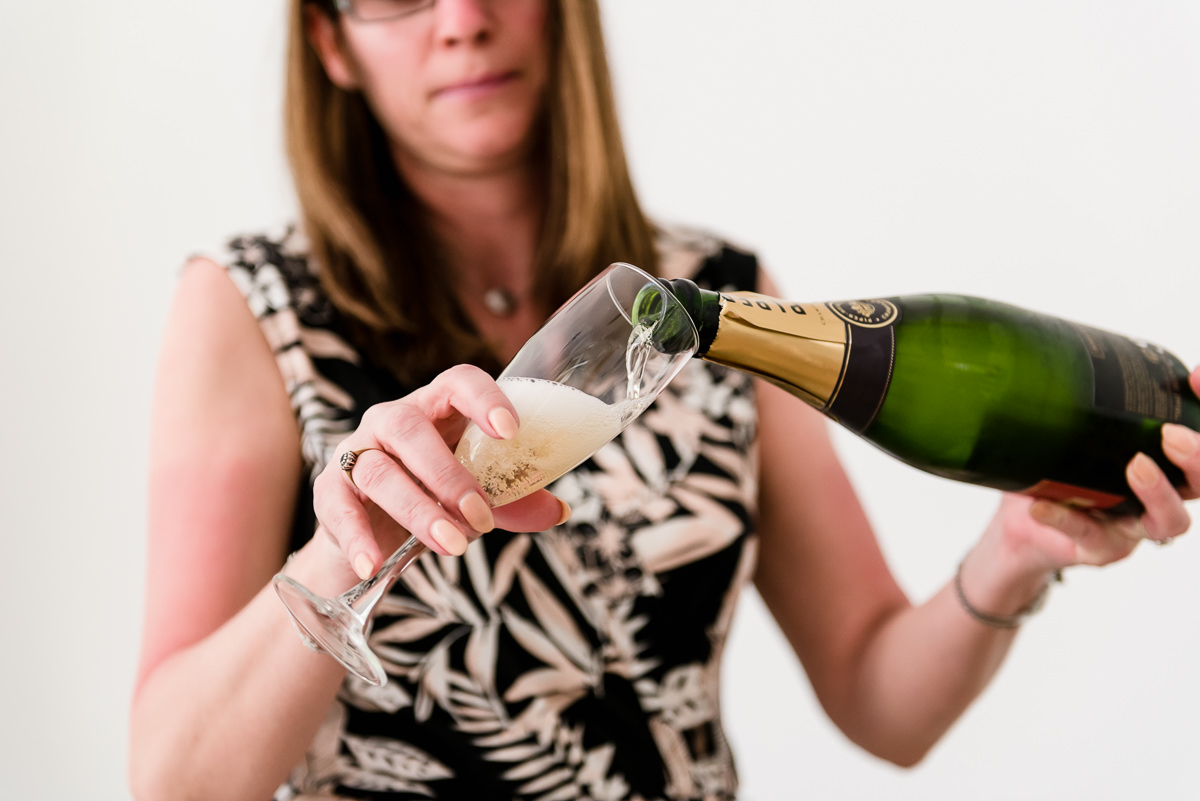 pouring champagne atspanish destination wedding