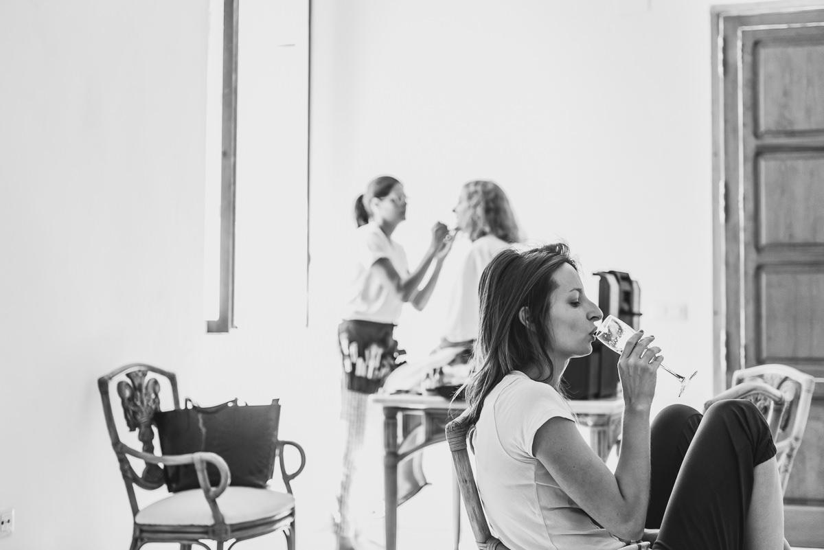 bride drinking champagne at casa santonja before her wedding