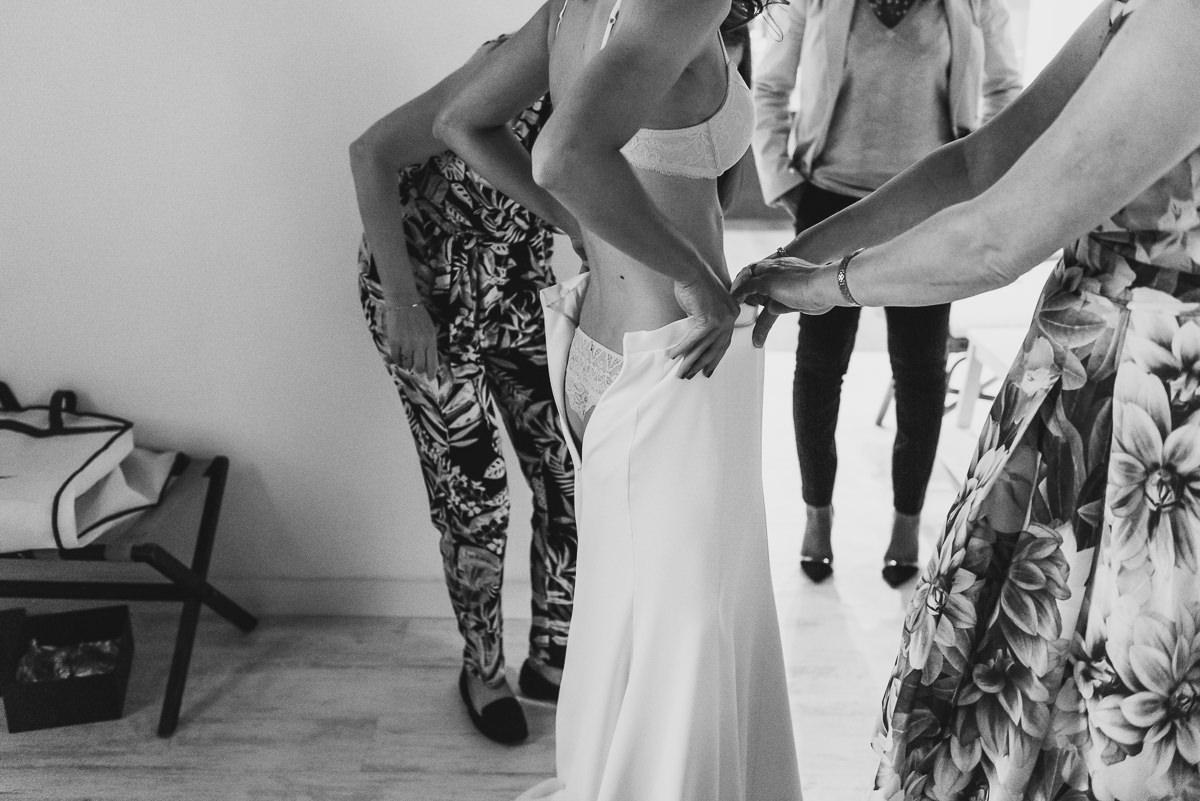 Bride putting her dress on ready for her Casa Santonja wedding
