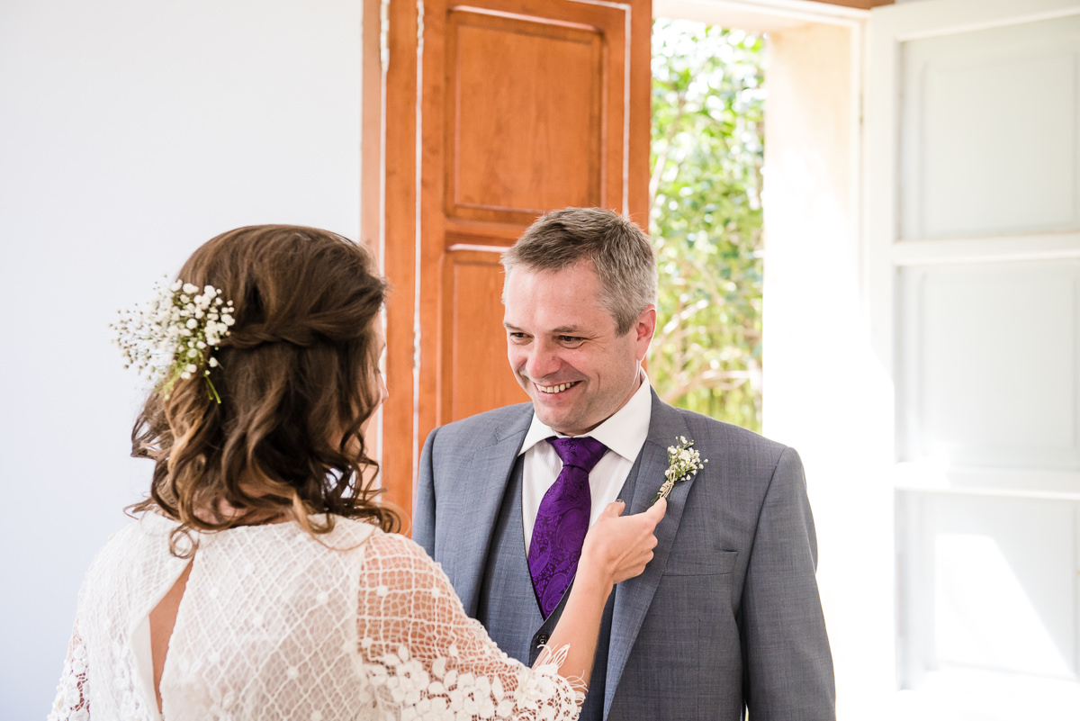Father of the bride sees bride in her wedding dress for the first time