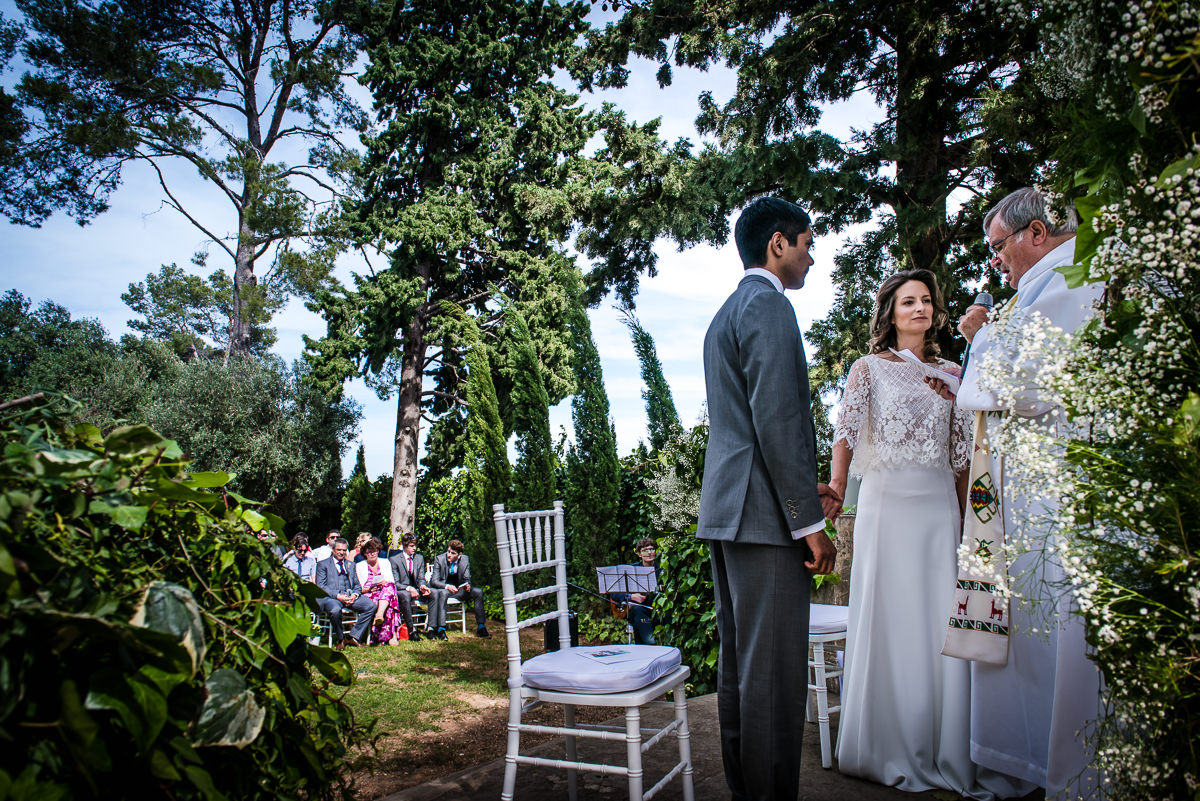 Bride and Groom at their garden wedding ceremony in Spain