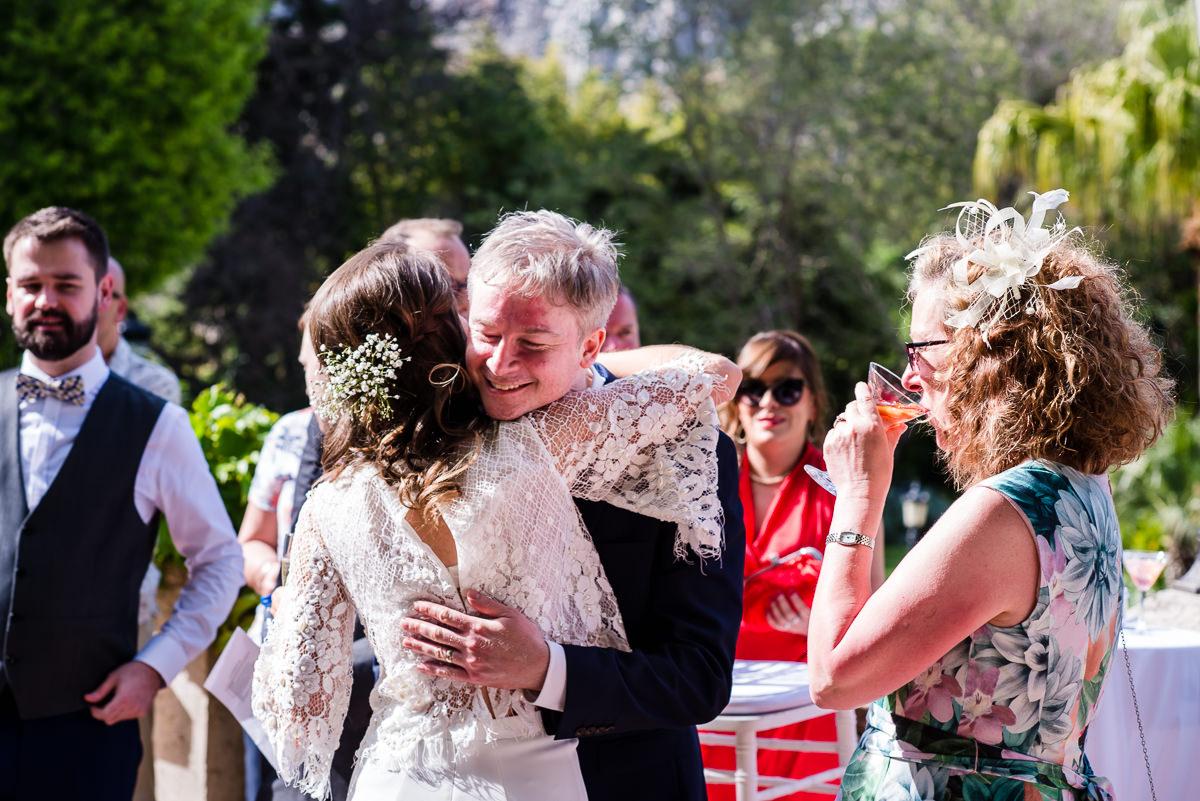 wedding guests hugging bride at destination wedding