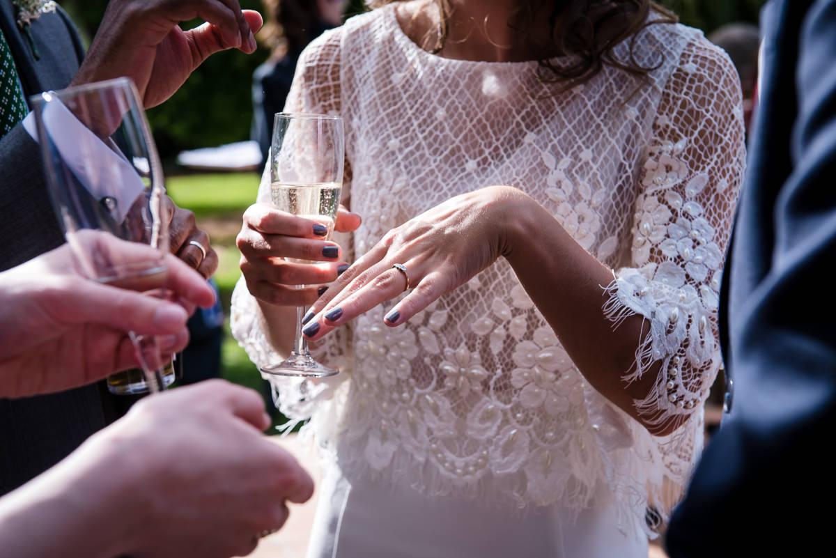 Bride showing guests her wedding ring at Casa Santonja