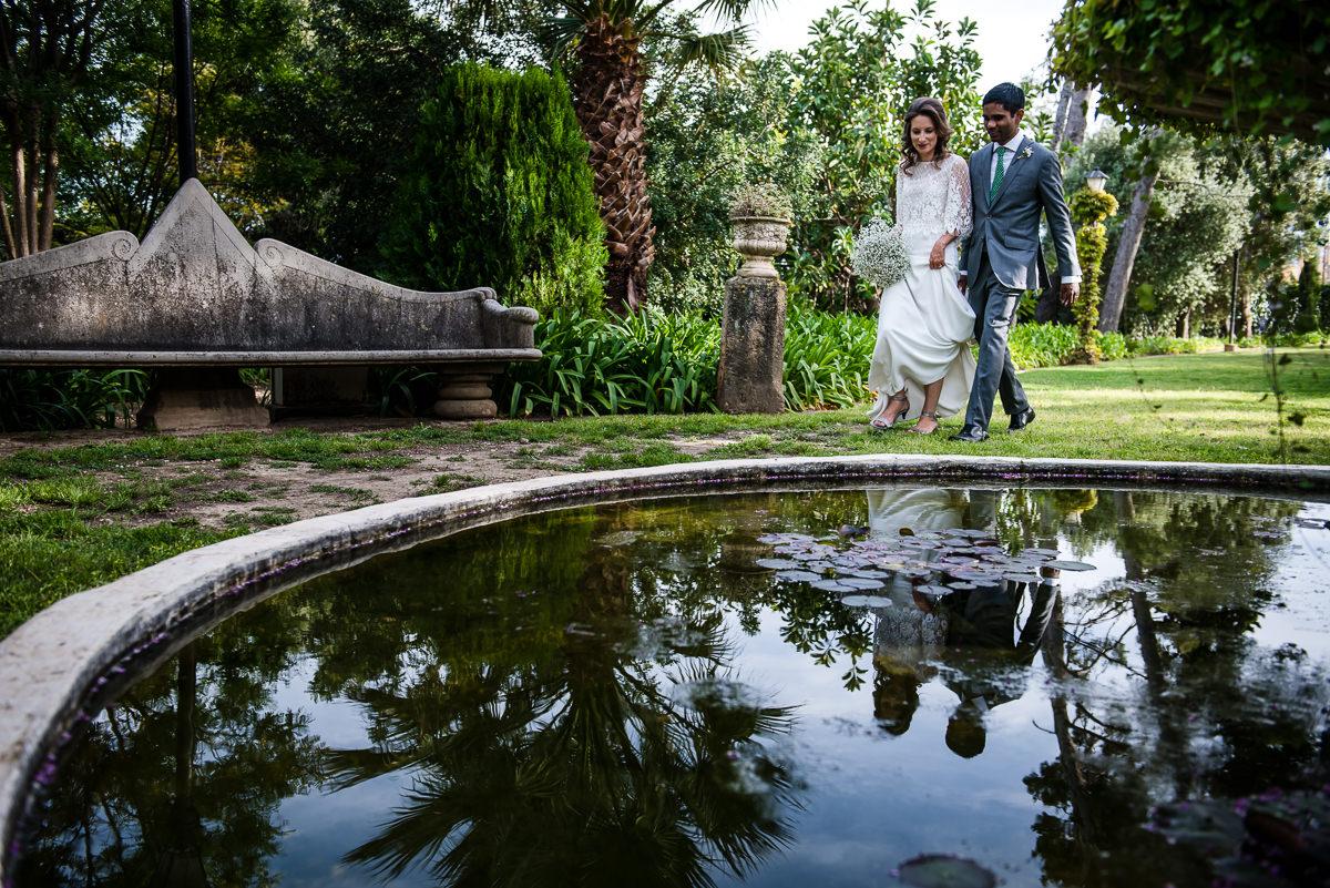 newly weds walking through the beautiful gardens at Casa Santonja