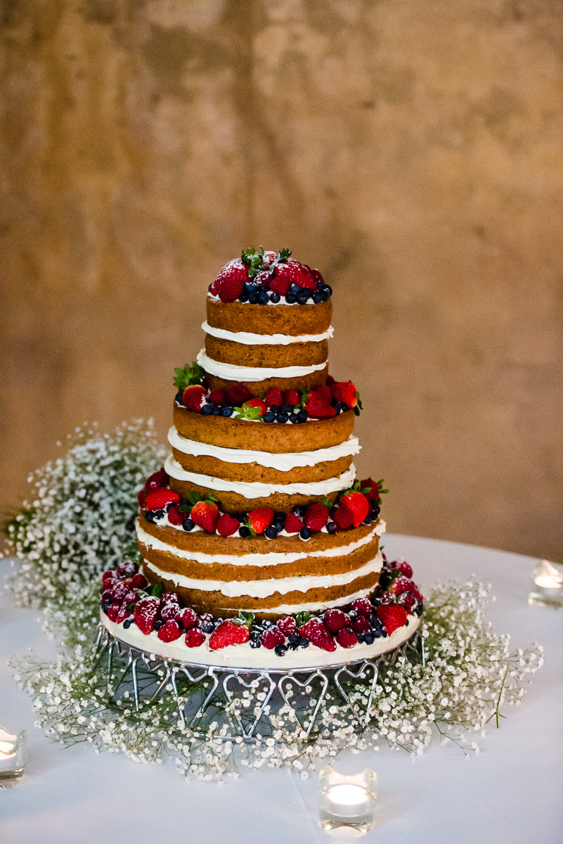 Layered sponge and fruit wedding cake at spanish wedding