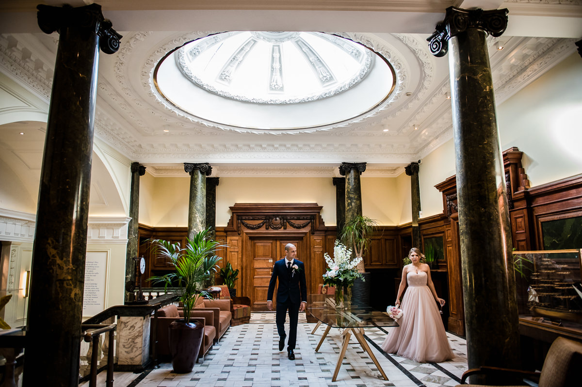 Bethnal Green Town Hall Hotel wedding bride and groom entering wedding breakfast room